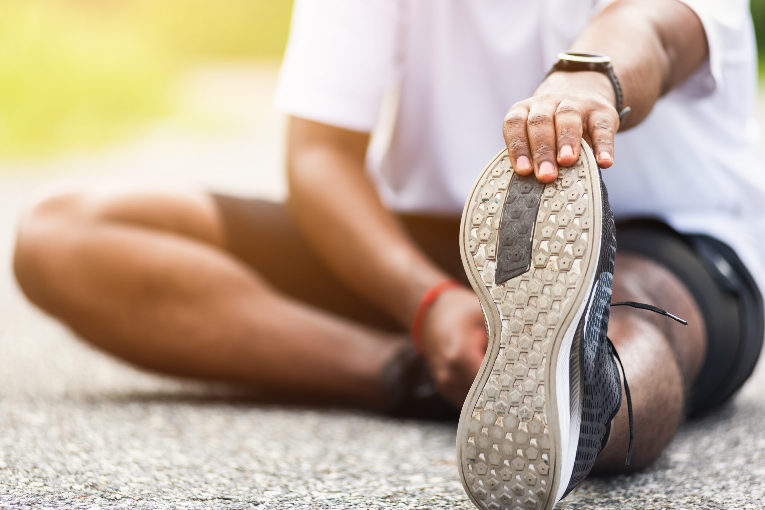 Runner stretching on pavement